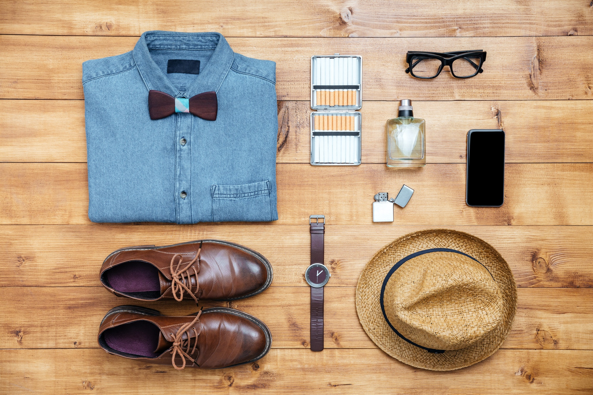 Travel concept shoes, shirt, mobile phone, watch, parfume, eyeglasses, hat