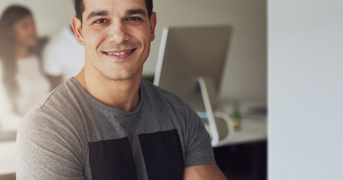 Confident man in small office